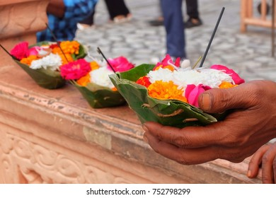 Flowers for Ganga Aarti ceremony in Parmarth Niketan ashram at sunset. Rishikesh is World Capital of Yoga, has numerous yoga centres that also attract tourists