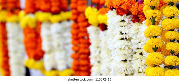 Flowers and garlands for sale at the flower market in India