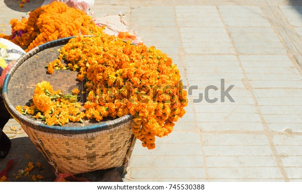 Flowers for garlands at the street market. Selective focus.