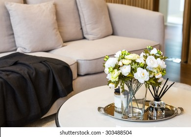 flowers in glass with incenses decorated in living room
