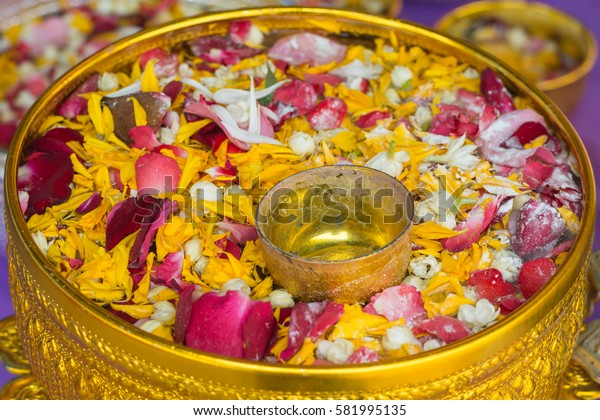 Flowers in gold water bowl, Songkran Festival, thailand