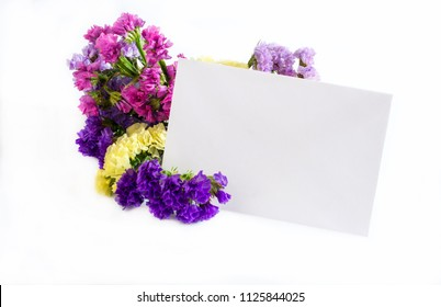 Flowers with greeting card on white background