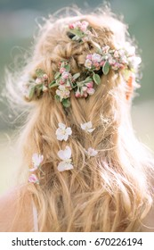 Flowers in the hair, bridal braid hairstyle.