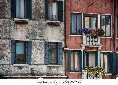Flowers hang on balcony in Venice