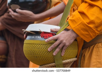 Flowers and incense in monk's alms bowl ,as stand for alms as old culture in Buddhism.