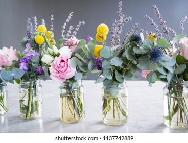 Flowers in jar, beautiful bouquet on table on gray background