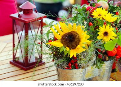 Flowers and lantern on a garden table