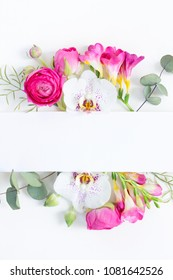 Flowers layout. Frame made of dried eucaliptus leaves and flowers on white background. Flat lay, top view, copy space
