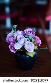 Flowers made of pink fabrics in a Vase on blown Table. in coffee shop, vintage color tone