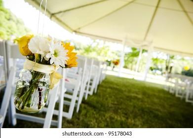 flowers in a mason jar at a wedding ceremony