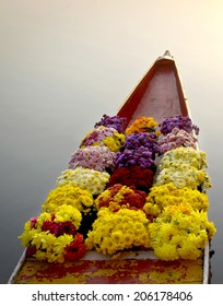 Flowers on boat at floating market in morning
