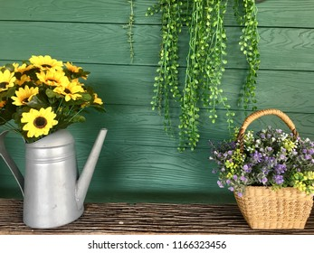 Flowers on a crock with flowers in a basket.