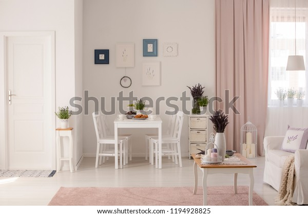 Amazing Flowers On Table Next Sofa White Stock Photo Edit Now Uwap Interior Chair Design Uwaporg