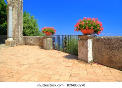 Flowers on a terrace above the sea, Amalfi coast, Italy