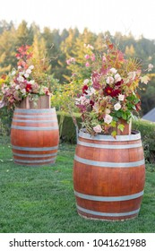 Flowers on Wine Barrel at Wedding Ceremony