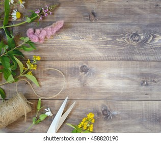 Flowers on wooden background. Top view