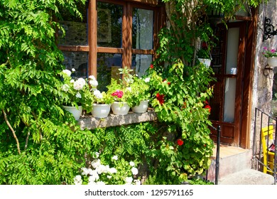 Flowers ornament a hotel in Behramkale Assos, Turkey