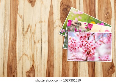 Flowers photos on wooden table