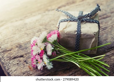 Flower gift stock images royalty free images vectors shutterstock flowers and present gift on wooden background holiday background negle Images