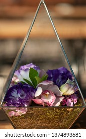 flowers in prism pot