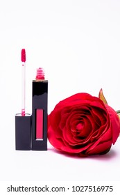 Flowers rose, lipstick brush uses lips for women,Flat lay fashion with lipsticks,beauty item isolated on white background