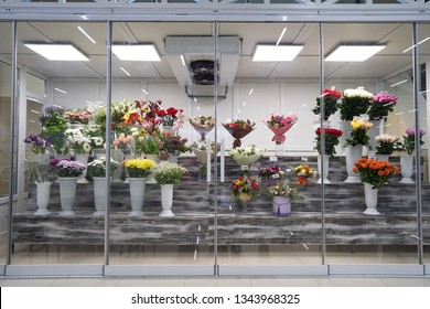 Flowers for sale in a special cold room with air conditioning. Refrigerator for flowers