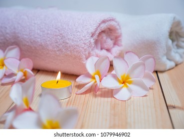Flowers and spa massage items in candlelight