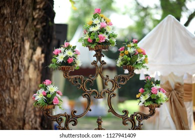 Flowers stand for rustic outdoor wedding decoration made from metal
