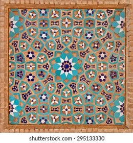 Flowers and stars motif design in Islamic Iranian pattern made of tiles and bricks in old Jame mosque of Yazd, Iran.