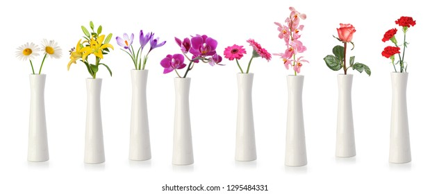 Flowers in tall white vases isolated on white
