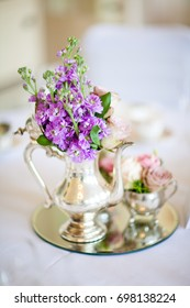 flowers in teapot wedding decor