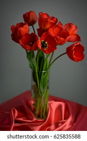 Flowers of tulips in a vase on a table