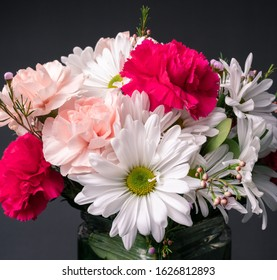 Flowers in a vase carnation daisy with a grey background