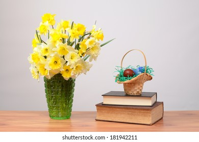 Flowers in a vase and Easter eggs on the table