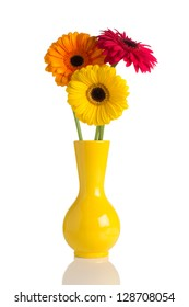 Flowers and vase isolated on te white backgroun.