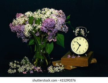 flowers in a vase - still life with lilac on a dark background