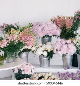Flowers in vases and pails. Flower shop.