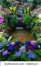 Flowers and waterfall in indoor garden, vancouver island, british columbia, canada