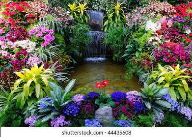 Flowers and waterfall inside the historic butchart gardens (over 100 years in bloom), vancouver island, british columbia, canada