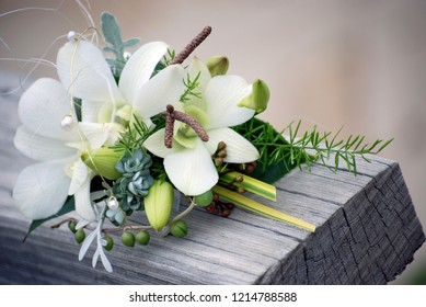 Flowers To Wear. Ladies Corsage, Floral Buttonhole of White Dendrobium Orchids.