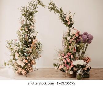 flowers wedding archs bohemian style.Wedding ceremony arch with flowers in rustic style. Wedding ceremony with fresh flowers