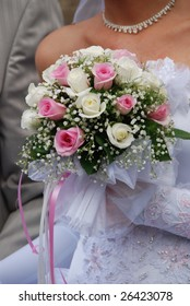 Flowers which are hold by a bride