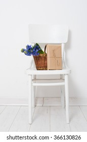 flowers and wrapped gift