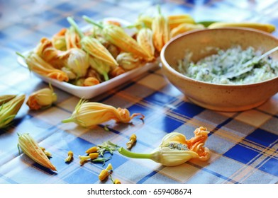 flowers zucchini or squash. Process of stuffing with soft cheese and greens.Crispy Herbed Goat Cheese Stuffed Zucchini Blossoms. Baked Zucchini Flowers with Ricotta.