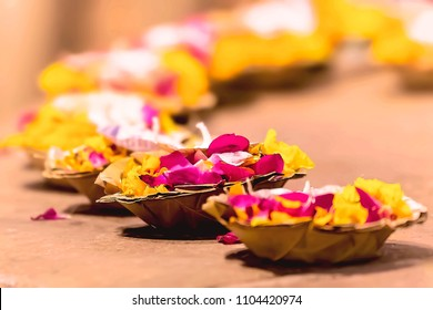 Flowerts and candles for prayers on the river Ganges in Varanasi, India