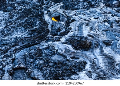 Flowing lava solidifies into a hard crust