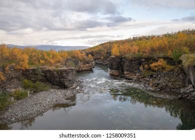 Flowing river in autumn. Abisko national park in Sweden.