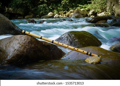 the flowing river and a bamboo flute