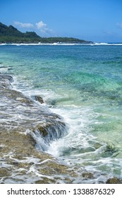 Flowing Sea Over Rocks at Siargao beach, Philippines