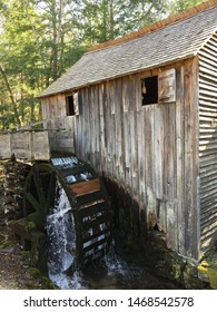 A flowing stream sounds wheel at a historic rustic mill